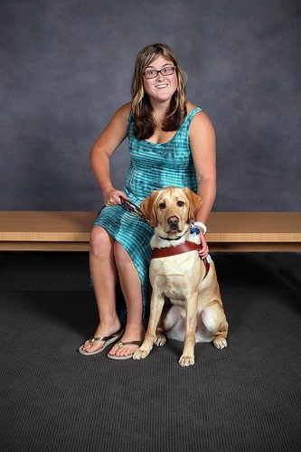 Elizabeth Fideler and her service dog, Victor, pose for a photo.