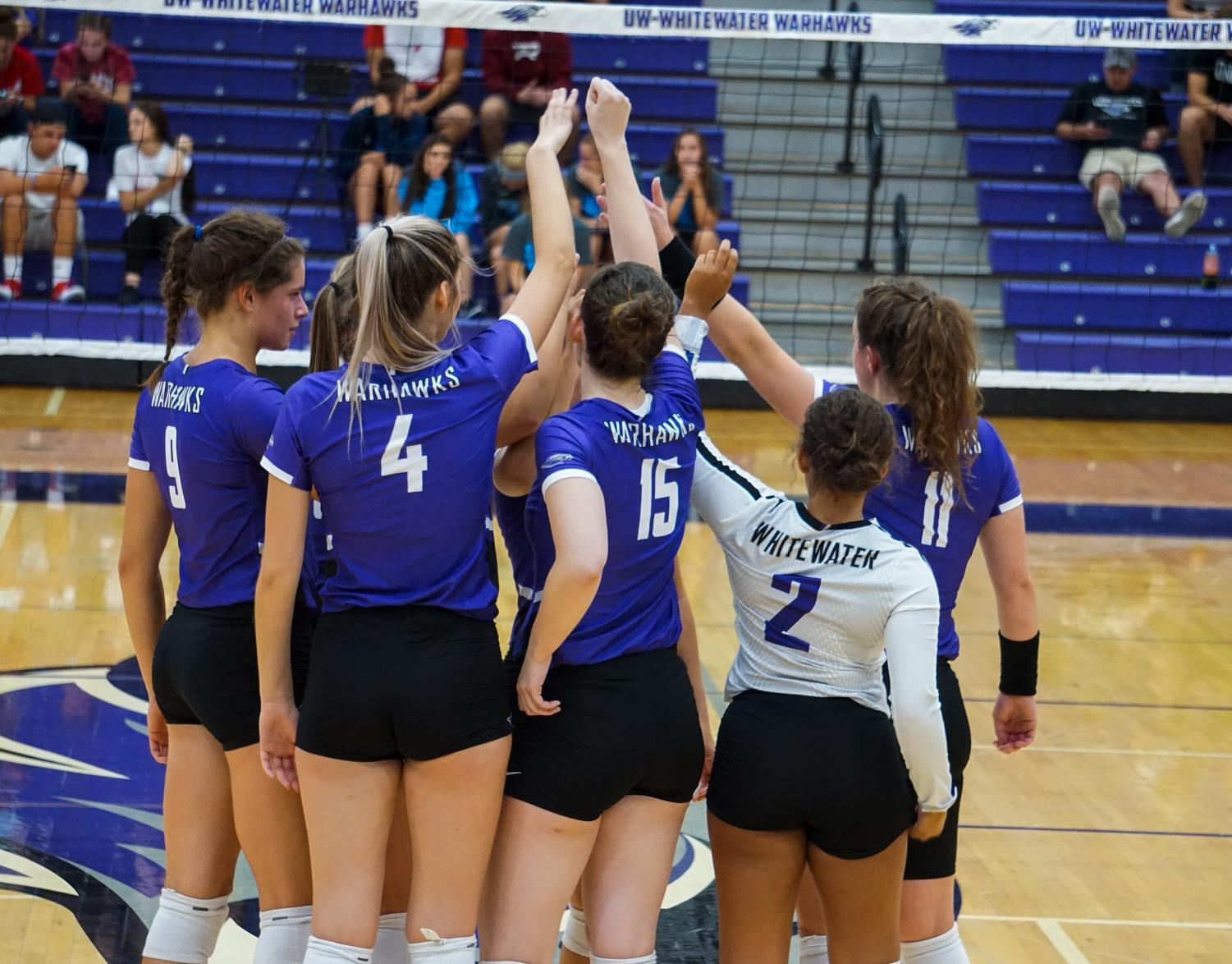 The Warhawks huddle before preparing for their match against Elmhurst College (Ill.) Sept. 11. Whitewater defeated the Blue Jays in three consecutive games 25-16, 25-15 and 27-25.