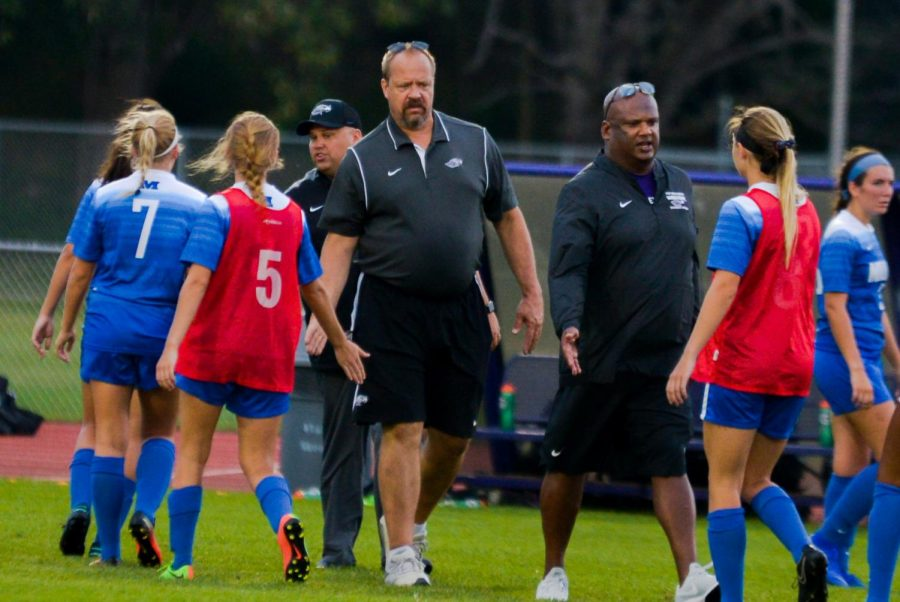 University of Wisconsin - Whitewater women's soccer coaches Ryan Quamme (far left) and Ben John (right) ready their team prior to a game last week. The pair reunited this season for UW-W.