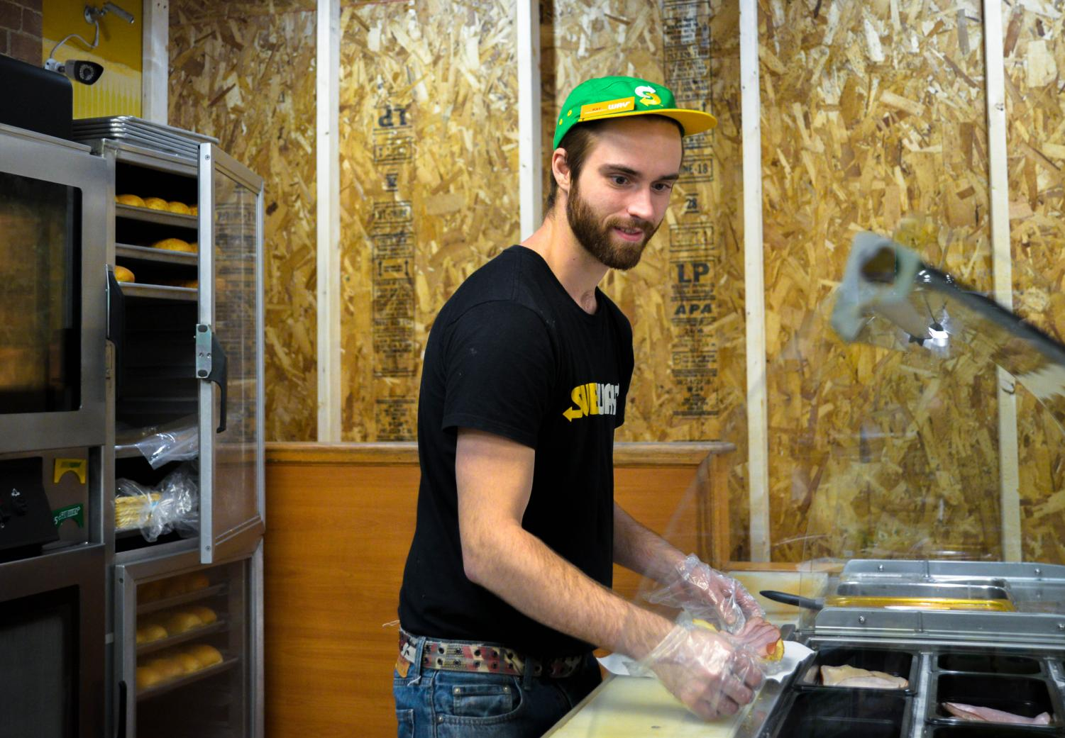 Garrett Lamb works on a customer's sandwhich order. The Subway at 1170 W Main Street, Whitewater is undergoing a few renovations during the next several weeks.