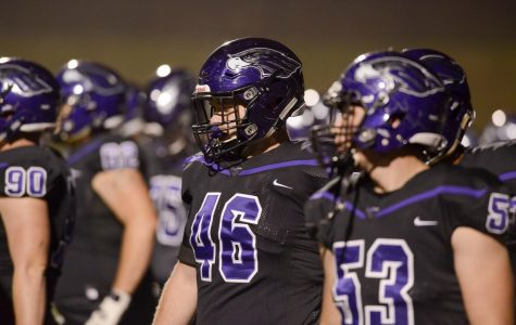 Football takes care of business in opener