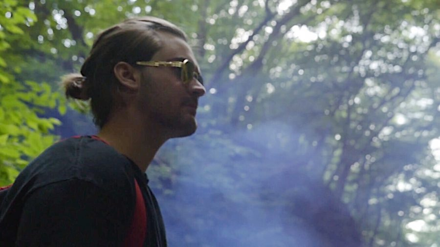 "A still image of Nick Borowitz from the music video ""Bloom."""