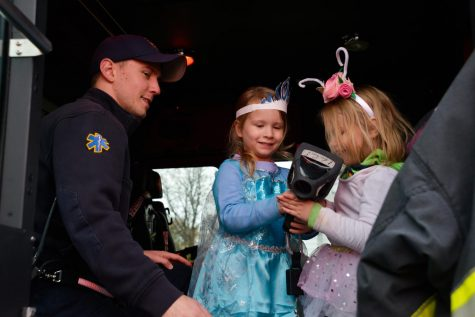 Whitewater police officer Carl Strait gives children a tour of an ambulance.