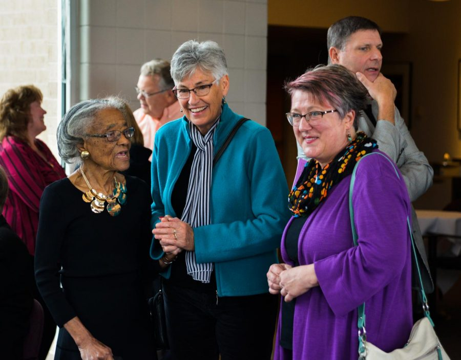 Fannie Hicklin is greeted by friends, former students and UW-Whitewater faculty Oct. 14. in Fern Young Terrace. She is pictured talking with retired faculty member Robin Pettersen and Anna DeWind Walls.