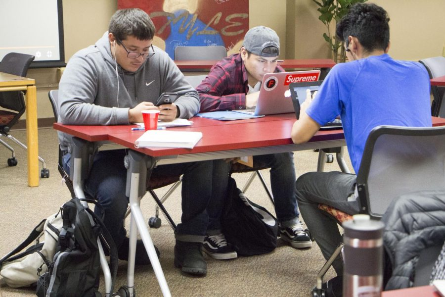 Sophomore+Ulysses+Quijano-Colunga%2C+left%2C+sophomore+William+Rosales+and+freshman+Jonny+Carbajal+study+together+Sept.+24+in+Andersen+Library.