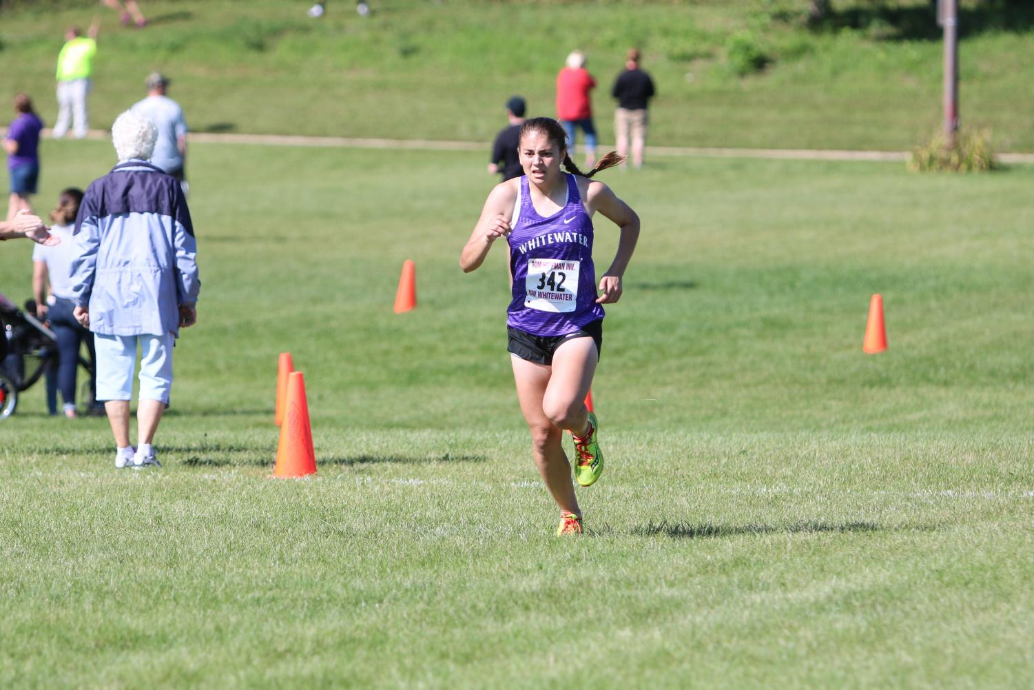 Junior Jessie Braun finishes her race Saturday, Sept. 10 at the Fifth Annual Tom Hoffman Invitational. Braun ran an official time of 24:17.8.