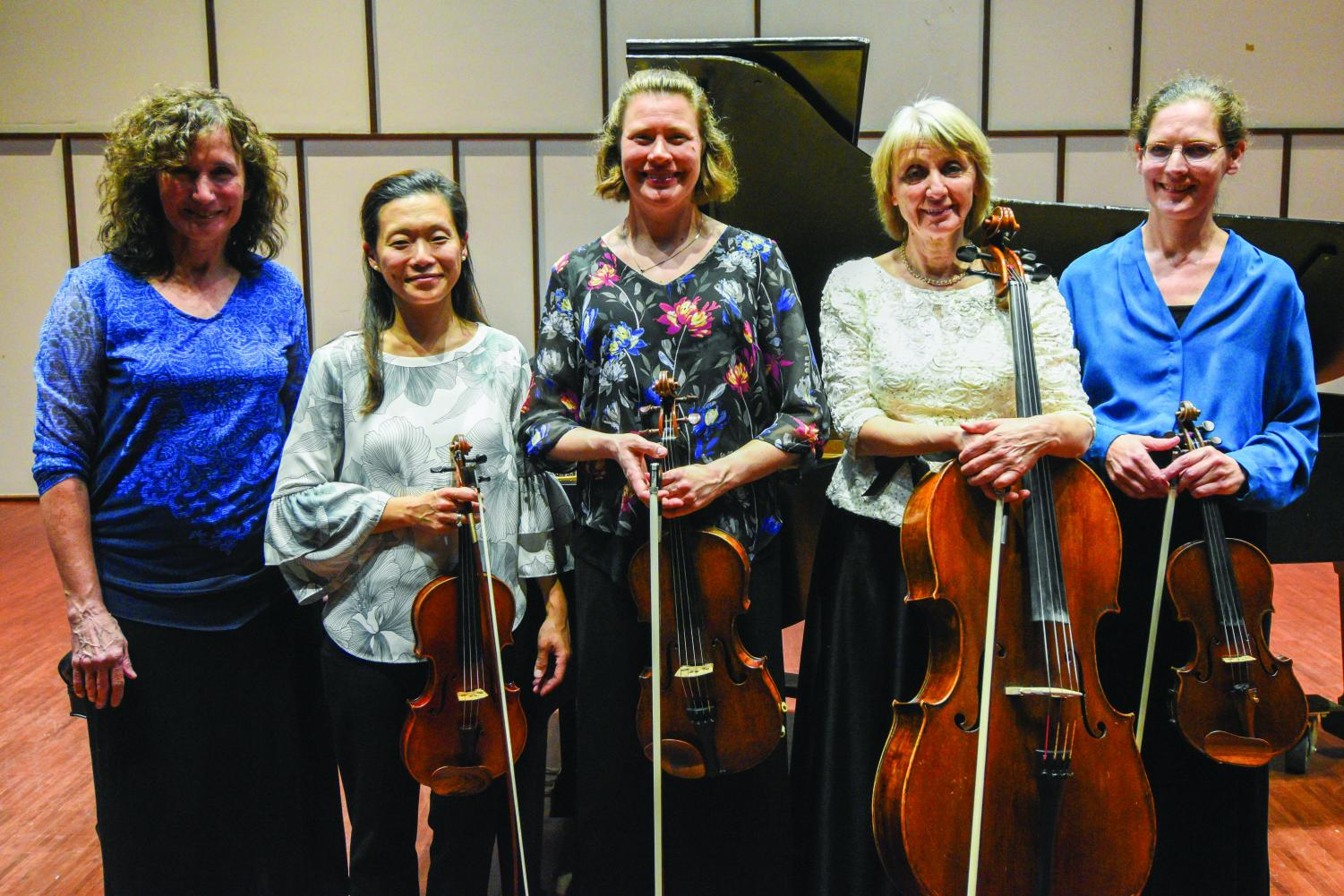 Members of the Illinois Chamber Music faculty posing with their instruments.