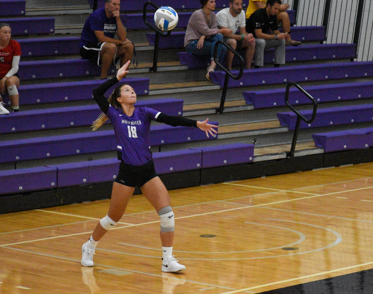 Hailey Mackenthun serves the ball during the Wednesday, Sept. 4 game where the Warhawks triumphed against the Carthage college with a score of 3 to 1.