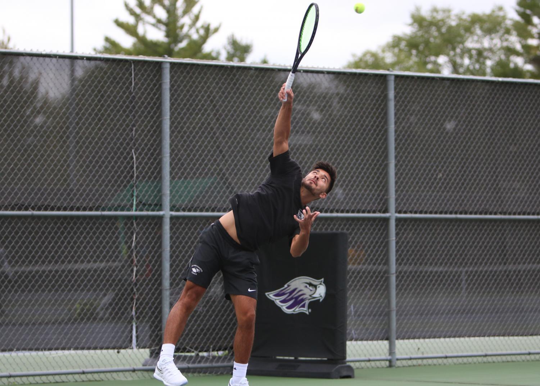 Sophomore Noah Guillermo hits a serve.