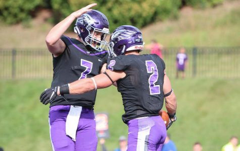 Quarterback, Max Meylor and Running Back, Ronny Ponick celebrate after a play at the Saturday, Sept. 7 game. The UW-Whitewater Warhawks dominated the University of Dubuque Spartans with a final score of 42 to 7. This marks the first game and Warhawk win of the season.