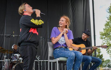 Pop singer Jesse McCartney serenades UW-W student Veronica Johnson.