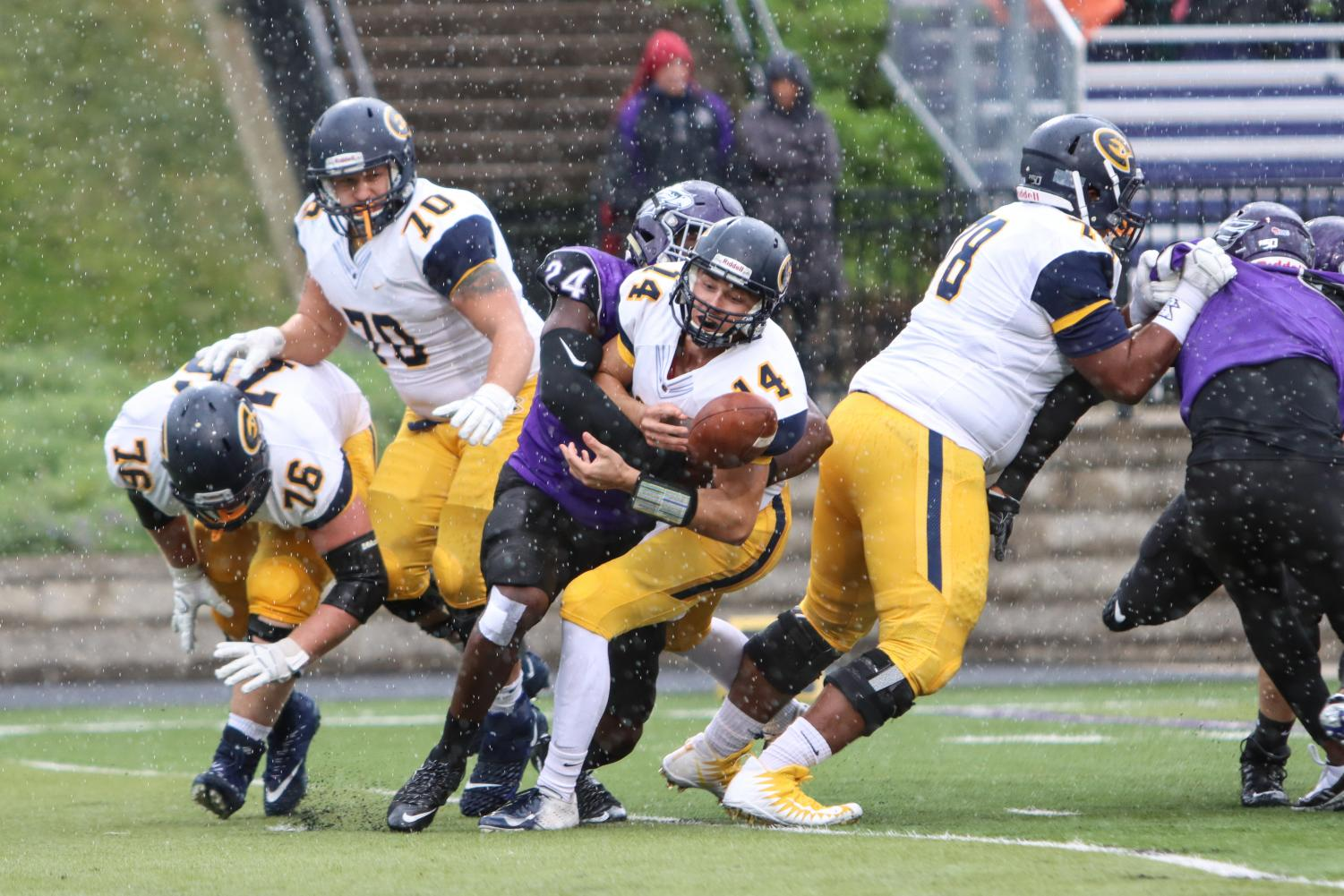 Senior defensive lineman Jordan Brand forces Eau Claire's quarterback Jonathan Malueg to fumble the ball just three plays into the game Saturday at Perkins Stadium. Brand finished the game with two sacks and four tackles.