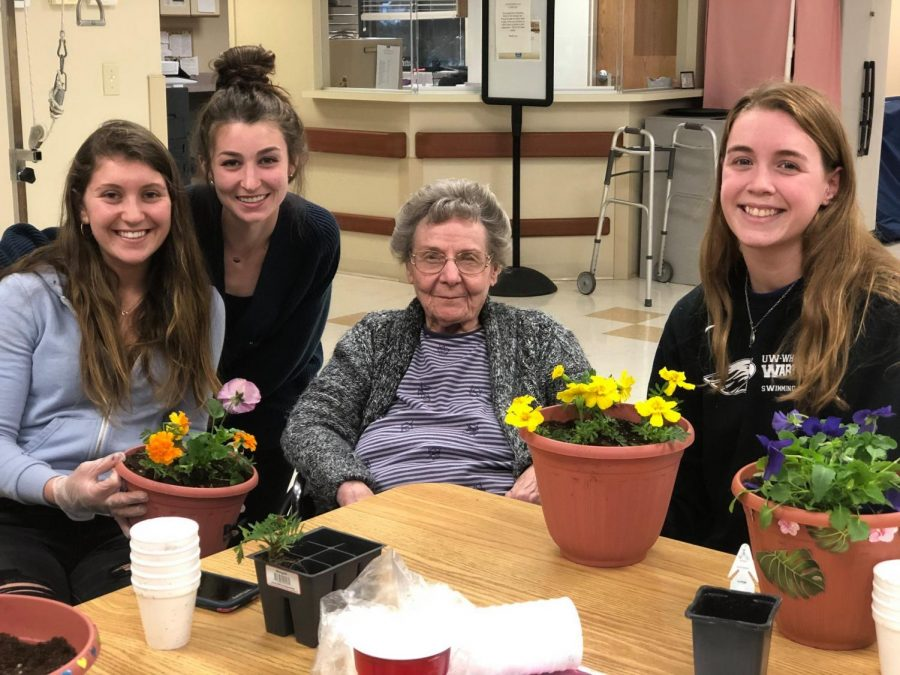 Residents and student volunteers spent the night gardening and potting plants together at Delevan Health Services last spring. NHVP continues to visit homes like Delevan's and others around the Whitewater area this semester, with the  addition of the Oak Park Place in Janesville this year.
