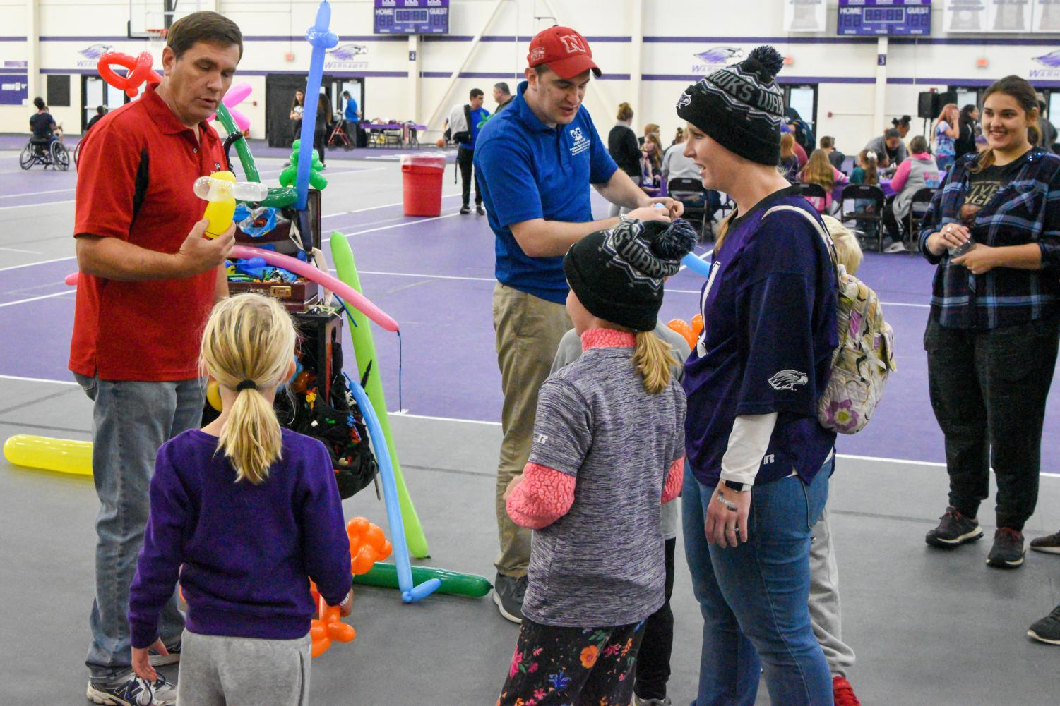 Families enjoy balloon making in the Kachel  Fieldhouse during the rainy Saturday, Oct. 5 Family Fest event.