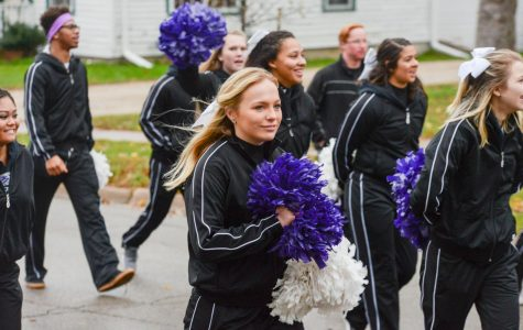 UW-Whitewater cheerleaders march in the Homecoming Parade.