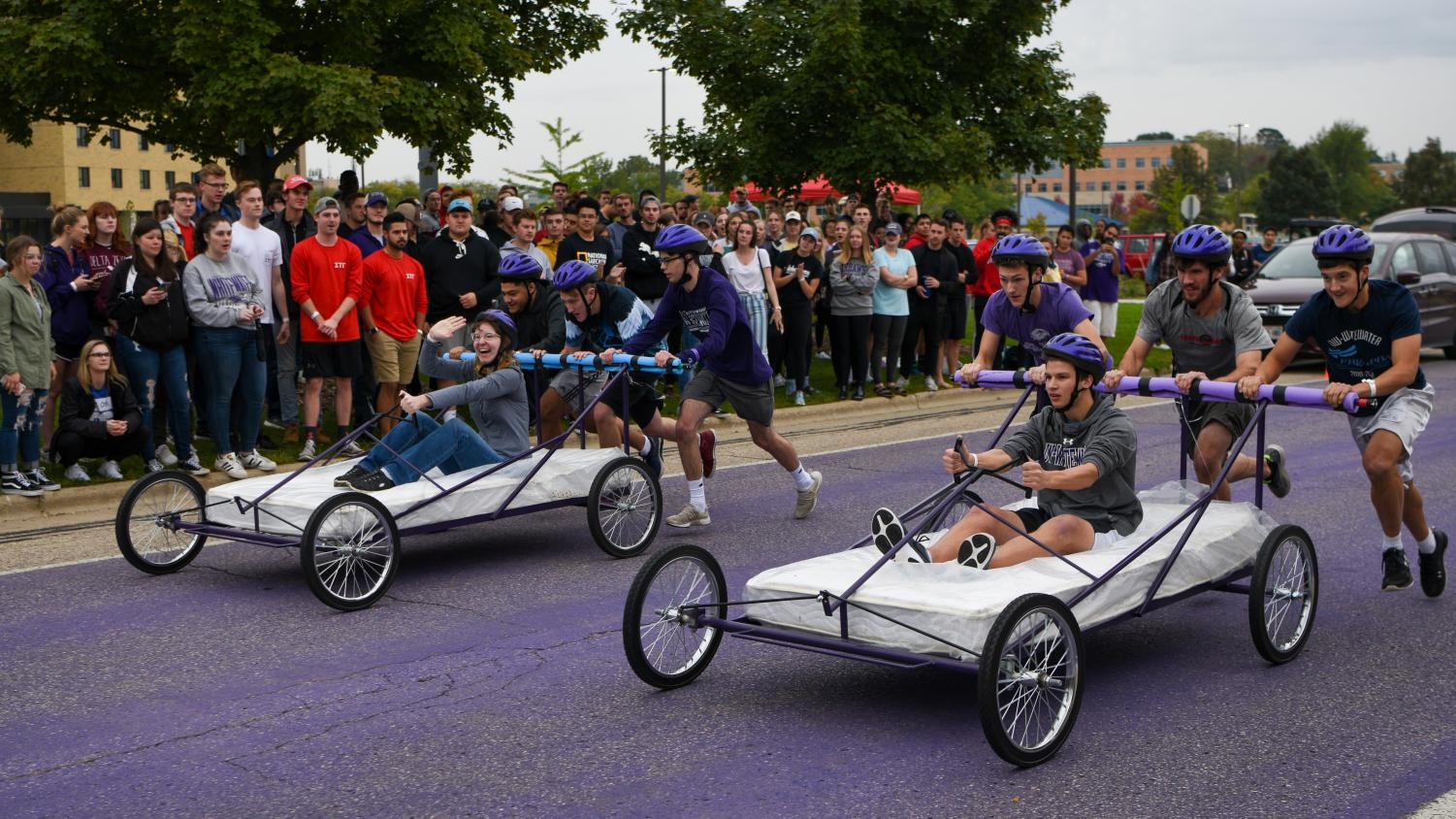 Members of student organizations run in the bed races.
