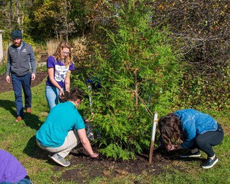 Participants of Whitewater Student Government's sponsored It's On Us week, panted trees during the tree planting memorial ceremony at the Campus Memory Garden.