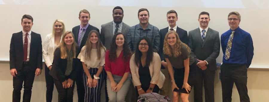 Students from the UW-Whitewater chapter of the American Marketing Association pose for a group photo after a weekly meeting Wednesday, Oct. 9.