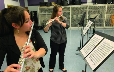 Students Traci Pinzon (left) and Becca Weber (right) warm up before the recital.