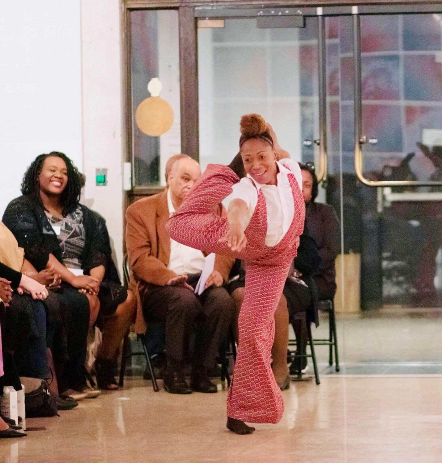 A performer entertains the audience in attendance with her contemporary dance routine.