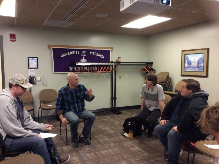(from left to right) Oscar Sorvick, Jayson Vosz, Joshua McBride, and Jonathan MacMartin in a discussion at ZOC's first meeting.