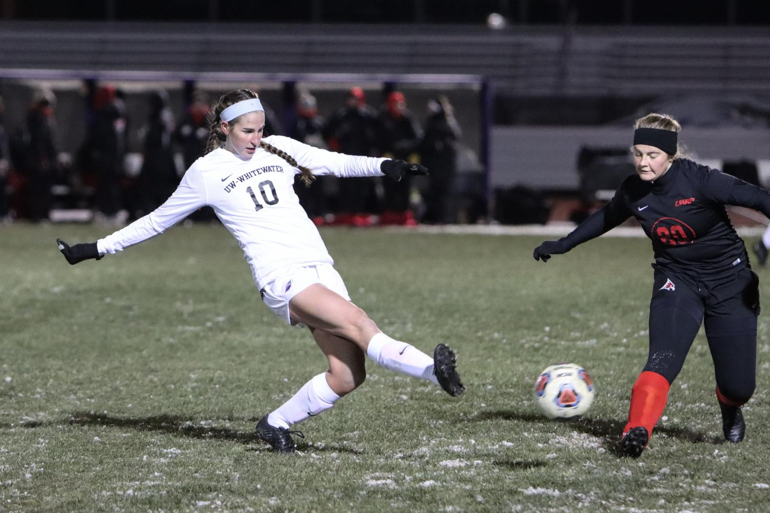 Junior forward Anna Brodjian attempts a goal kick in the semifinal game of the WIAC Conference Championship.