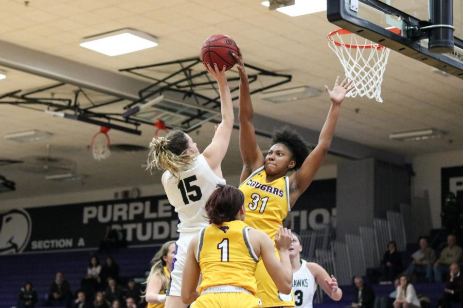 UW-W+sophomore+guard+Veronic+Kieres+drives+to+the+hoop+against+Concordia+Chicago.+The+Cougars+played+multiple+defensive+fronts%2C+trying+to+confuse+the+Warhawks.+It+caused+turnovers%2C+but+also+led+to+baskets.