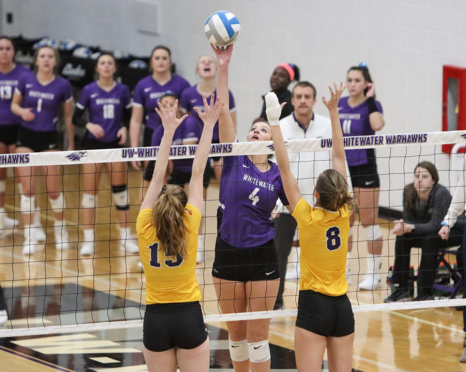 Erin McNeil splits the UWSP blockers during the first set.