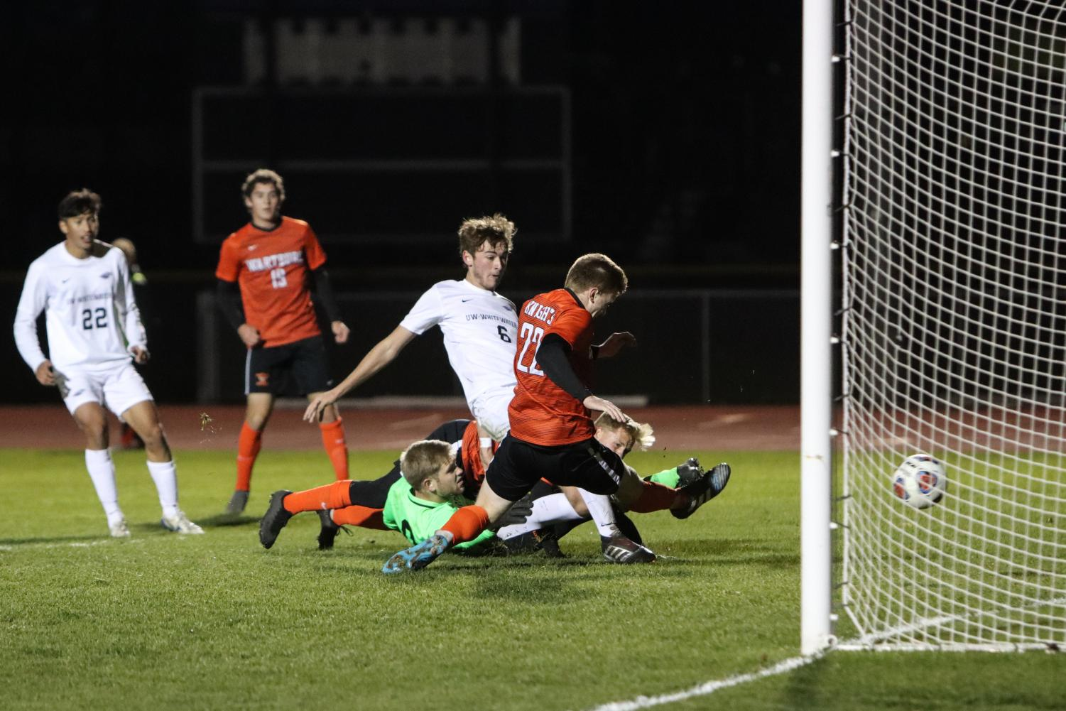 After a Goulmouth scramble, Mariano Carini puts the ball into the net for the Warhawks.