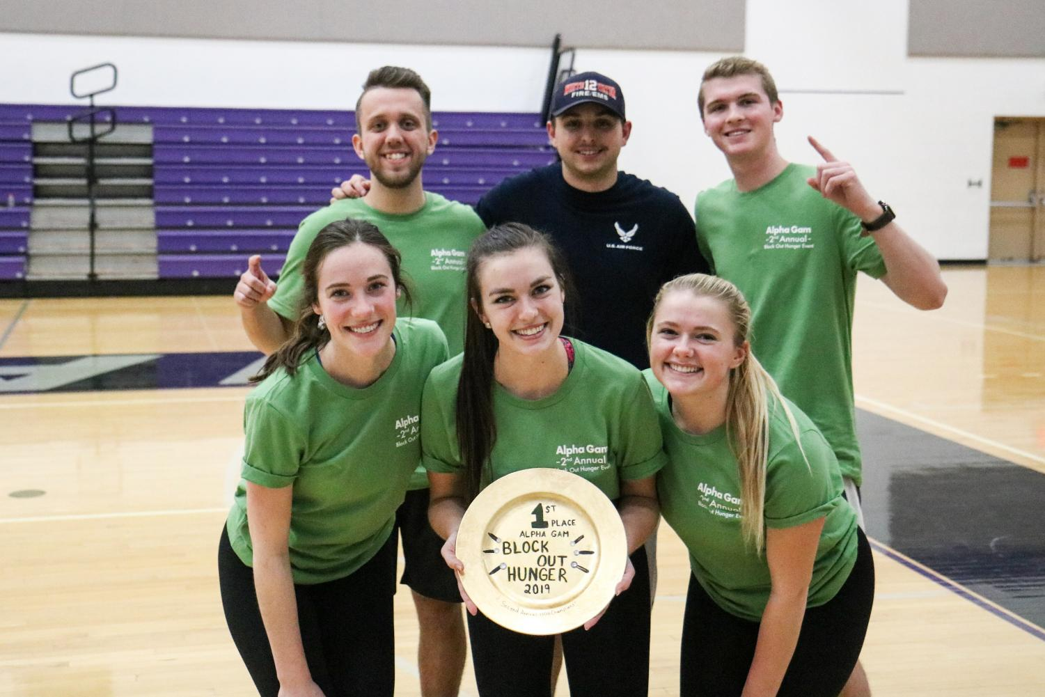 Alpha Gamma Delta's 2nd Annual Block Out Hunger volleyball tournament first place team poses for a championship photo.