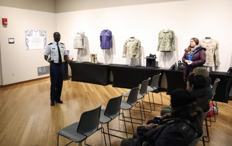 Sergeant Richard Harris delivers a presentation to  attendees of the Women of Valor exhibit on Veteran's Day.