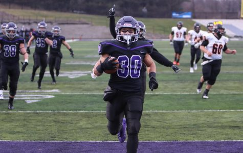 Senior wide receiver Justin Prostinak enters the endzone after returning a punt for a touchdown to go up 17-0 in the first quarter against Wartburg.