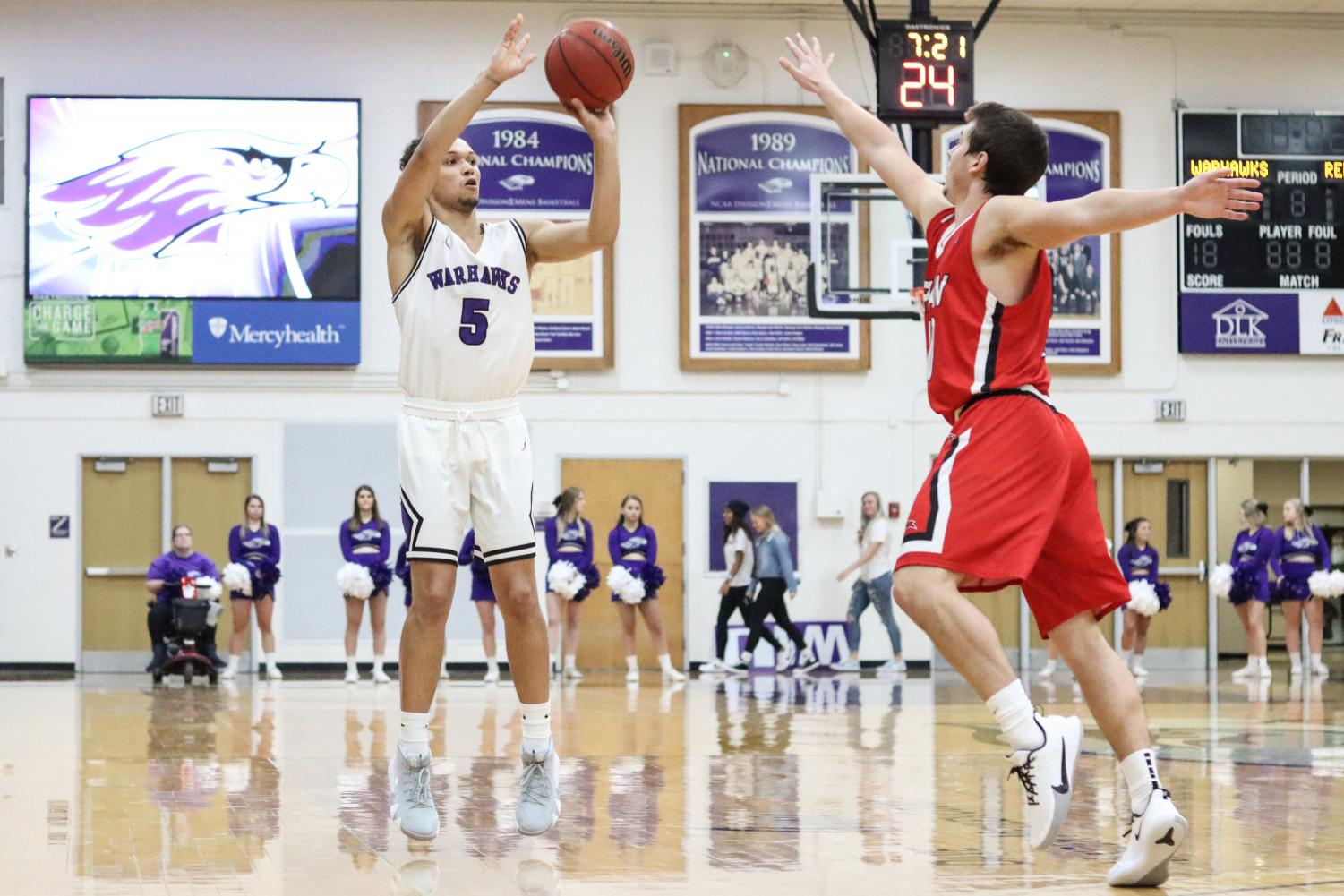 Sophomore Kale Bailey shoots from outside against Ripon College. Bailey finished with 8 points and 8 assists.