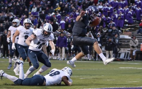 Junior QB Max Meylor hurdles a defender on his way to the endzone. He rushed for 3 touchdowns on the season, including the final score against UMHB on Saturday, Dec. 7. Meylor has also thrown for 800 yards this year.
