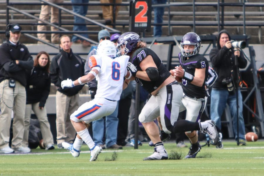 Quinn Meinerz (#77) clears the way for Zach Oles (#5) against No. 19 UW-Platteville as Head Coach Kevin Bullis (left) watches on.