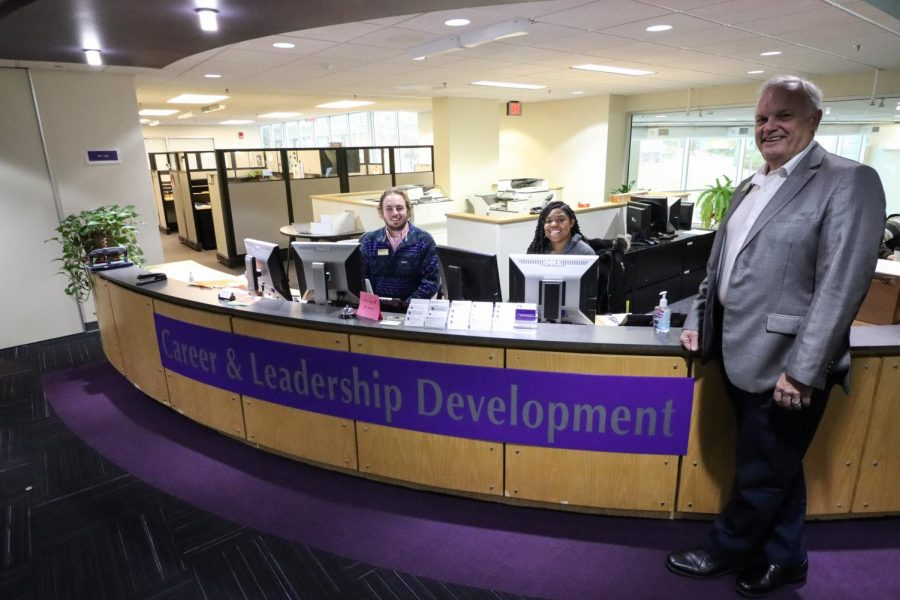 Pictured from right to left: Career and Leadership Development Director Ron Buchholz with two customer service associates, Ben Boland and Aleyah Coleman. The three sit in the Career and Leadership Development office, ready to help students achieve current and future successes.