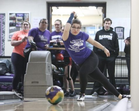 Piper Miles rolls her ball down Warhawk Alley in front of teammates during practice for the Dec. 7 event.