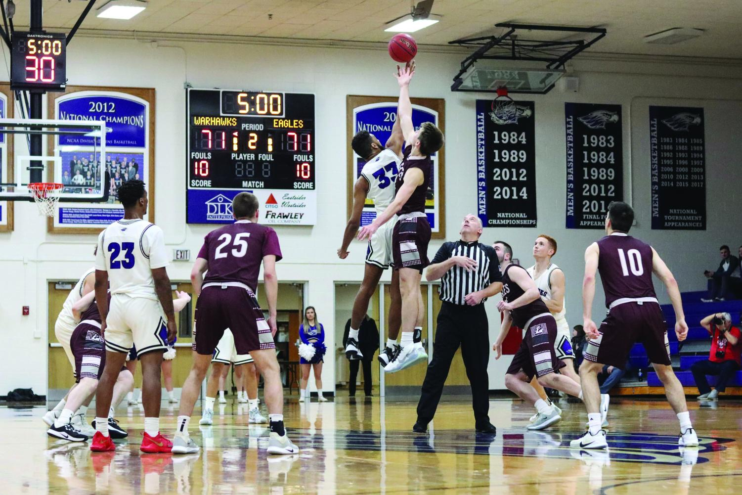 Trevon Chislom squares up for the tipoff to begin overtime. The Warhawks tied the game late in the fourth quarter, forcing overtime. However, they ran out of gas allowing La Crosse a 9-0 run in the last period of play.