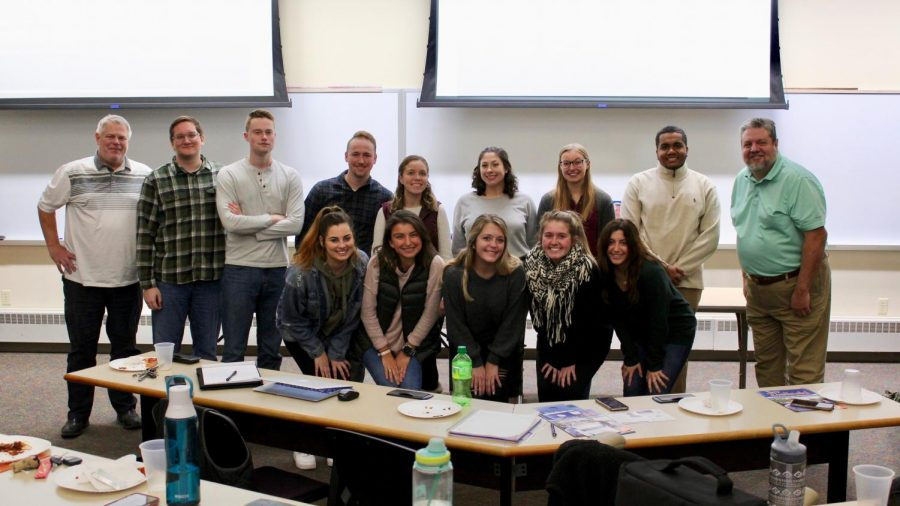 Members and interns for the Whitewater Advertising Association gather for a group picture during a weekly meeting.