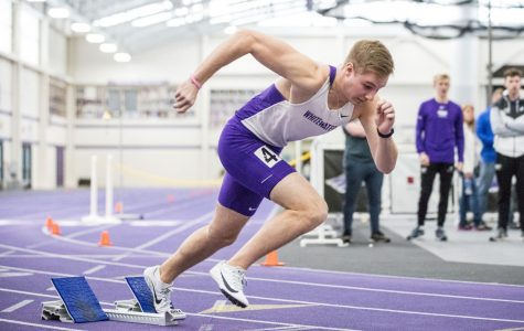 Junior Lucas Skaaland comes off the blocks on the back side of the track. He won his event, the triple jump, with a distance of 13.60 meters.