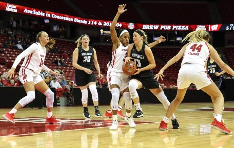 Senior Becky Raeder (13) drives past Suzanne Gilreath to score a basket at the Kohl Center in November. She celebrated Senior Day, along with Megan Corcoran, during halftime of the game against UW-River Falls