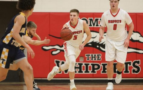 Brock Grosinske (5) brings the ball up the court in front of Jake Martin (0) against Turner on Tuesday at home. Martin finished with 19 points.