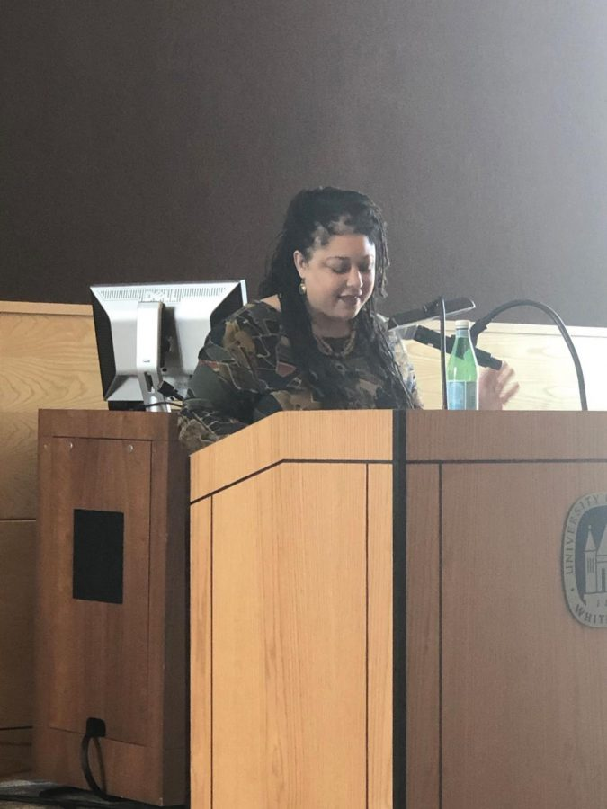 Dr. Sonya Maria Johnson explains to the audience her research about the nature of homemaking within certain circumstances among African descendants.