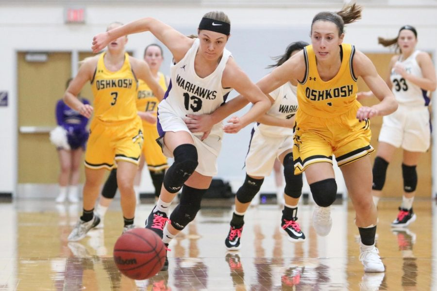 Becky+Raeder+%28Left%29+scrambles+for+the+loose+ball+in+the+semifinal+loss+to+UW-Oshkosh.+She+finished+with+five+points+and+two+assists+in+what+could+be+her+last+home+game+in+Warhawk+colors.+