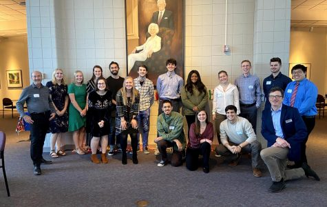 Students pose for a photo after the annual re-entry dinner hosted by the Office of Global Experiences.