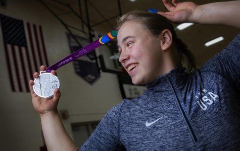 UW-Whitewater women's wheelchair basketball player Lindsey Zurbrugg is shown with the silver medal she received as a member of Team USA at the Parapan American Games in Lima, Peru, in August 2019. She will play as a Warhawk in 2019-20 and hopes to qualify again for Team USA ahead of  the 2020 Paralympic Games in Tokyo.