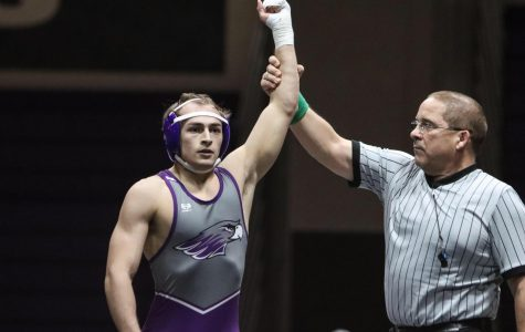 Senior Mike Tortorice has his hand raised in victory after a previous match this season. The senior was headed to the national tournament before it was cut short.
