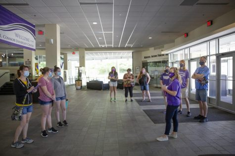 Jackie Briggs, front right in purple, Director of Admissions, leads a tour in the University Center lobby. UW-Whitewater admissions staff visited with incoming and prospective students and their families and guided small tour groups around campus on Thursday, July 16, 2020.