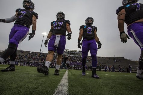 The team captains, from left, defensive back Nate Tranel, linebacker Jacob Erbs, running back Ronny Ponick and offensive lineman Quinn Meinerz approach midfield for the coin toss. UW-Whitewater defeated St. John's University (Minnesota) 35-32 in a Div. III NCAA national championship football semifinal game on Saturday, Dec. 14, 2019, at Perkins Stadium in Whitewater.