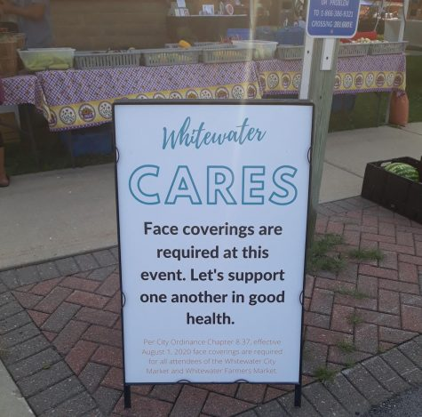 A sign displayed at the Whitewater City Market lets all shoppers know that masks are required for the health and safety of one another.